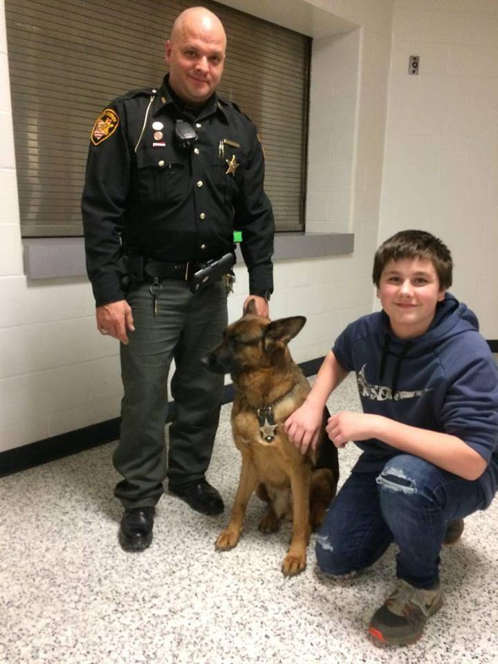 Police officer with police dog and student